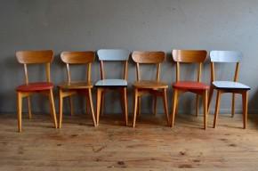 Tonus et vitalité sont au rendez-vous avec ce sexet de chaises Rockabilly. Cet ensemble dépareillé reflète une époque où le mobilier était aussi joyeux que coloré. Constituée de trois paires de chaises, cette jolie série de 6 apportera joie et bonne humeur à une cuisine aux accents pop. Les structures et dossiers en bois contrastent joliment avec les assises en skaï coloré, bois brut et formica.