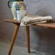 Élément de mobilier traditionnel dans les campagnes alsaciennes, ce joli banc rustique possède une patine formidable et une allure dépouillée et d'une grande sobriété. Ce banc de ferme ancien est fait d'une planche épaisse, soutenue par un fin piétement oblique, éloge au minimalisme paysan.  Sa simplicité le rend indémodable et d'une actualité étonnante. Il pourra reprendre du service autour d'une jolie table ou être détourné dans une salle de bain pour y déposer draps de bain et plantes grasses!